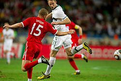 Matt Upson of England vs Tim Matavz of Slovenia during the 2010 FIFA World Cup South Africa Group C Third Round match between Slovenia and England on June 23, 2010 at Nelson Mandela Bay Stadium, Port Elizabeth, South Africa.  (Photo by Vid Ponikvar / Sportida)