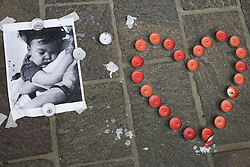 April 26, 2018 - Krakow, Poland - A picture of Alfie Evans and candles in front of the British Consulate in Krakow, Poland on 26 April, 2018. (Credit Image: © Beata Zawrzel/NurPhoto via ZUMA Press)