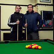 Two male customers playing pool at the Parson Cross pub, Sheffield, South Yorkshire, UK