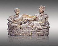 Etruscan cinerary, funreary, urn cover depicting a husband and wife,  from the Padata Necropolis, Chianciano, end of 5th century B.C., inv 94352 National Archaeological Museum Florence, Italy , against grey .<br /> <br /> If you prefer to buy from our ALAMY PHOTO LIBRARY  Collection visit : https://www.alamy.com/portfolio/paul-williams-funkystock - Scroll down and type - Etruscan Florence - into LOWER search box. (TIP - Refine search by adding a background colour as well).<br /> <br /> Visit our ETRUSCAN PHOTO COLLECTIONS for more photos to download or buy as wall art prints https://funkystock.photoshelter.com/gallery-collection/Pictures-Images-of-Etruscan-Historic-Sites-Art-Artefacts-Antiquities/C0000GgxRXWVMLyc