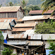 Corrugated iron rooftops of the buildings along the waterfront in Nong Khiaw on the Nam Ou (River Ou) in northern Laos.