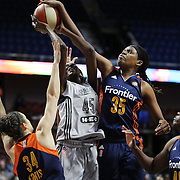 UNCASVILLE, CONNECTICUT- MAY 05:  Astou Ndour #45, (Center), of the San Antonio Stars is fouled as she drives to the basket by Kelly Faris #34 of the Connecticut Sun as Jonquel Jones #35 of the Connecticut Sun blocks the shot during the San Antonio Stars Vs Connecticut Sun preseason WNBA game at Mohegan Sun Arena on May 05, 2016 in Uncasville, Connecticut. (Photo by Tim Clayton/Corbis via Getty Images)