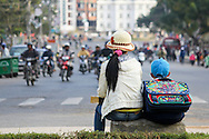 Mother and son wait on the side of the road during commute, Dalat, Lam Dong Province, Vietnam, Southeast Asia