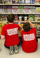 """Karter Dolloff and Jeremy Kuhn place stickers on alcoholic beverage packaging at Vista Foods as part of the """"Sticker Shock"""" program with Stand Up Laconia and Laconia Middle School eighth graders.  (Karen Bobotas/for the Laconia Daily Sun)"""