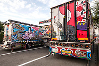 """Are they long-haul discos, works or art on wheels, personal statements of truck drivers? Dekotora is an abbreviation for decorated truck.  These gaudy, tricked-up trucks are usually found in rural areas of Japan where wheels are important.  Though artistically decorated trucks and buses can be found outside Japan, what sets the Japanese version apart is the level of expertise, artistry and intricate finishes on the lighting apparatus and paint jobs.  They are usually best viewed when illuminated thanks to their neon, ultraviolet, strobe and flashing lights.  Occasionally they are even fitted with fancy interiors with chandeliers and other paraphernalia to give them an added kick.  These unique trucks first came onto the scene in the 1970s, and appeared in the public consciousness with the Japanese movie """"Trucker Guys"""".  Some decotora follow historical themes while others show more interest in animals or are all about lights.  Tigers and dragons are favorites.  Even some video games have taken on the theme of dekotora with trucks as heroes or villains."""