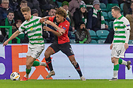 Kristoffer Ajer (#35) of Celtic & Sacha Boey (31) tussle for the ball during the Europa League match between Celtic and Rennes at Celtic Park, Glasgow, Scotland on 28 November 2019.