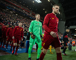 LIVERPOOL, ENGLAND - Wednesday, March 11, 2020: Liverpool's captain Jordan Henderson leads his side out before the UEFA Champions League Round of 16 2nd Leg match between Liverpool FC and Club Atlético de Madrid at Anfield. (Pic by David Rawcliffe/Propaganda)