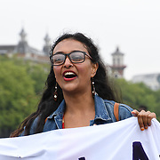 Muslimahs Resist Trump upon his state visit to the UK, with a big banner hanging from Westminster Bridge, London (UK) on 12 July 2018.