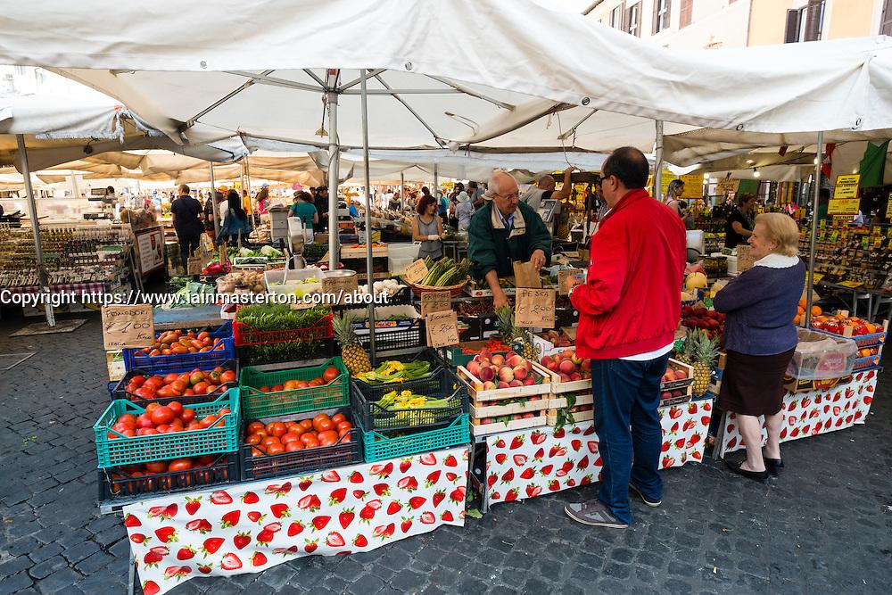 Traditional daily farmers market on Campo de Fiori square in Rome , Italy