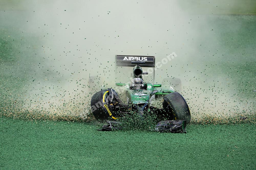 Kamui Kobayashi (Caterham-Renault) crash out of the 2014 Australian Grand Prix in Albert Park, Melbourne. Photo: Grand Prix Photo