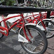 Red bikes on a bikesharing rack in Mexico City, Mexico.