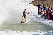 Warwick, NY - A skier tries to cross the water at the end of a run during the Spring Rally at Mount Peter in Warwick on March 29, 2008.
