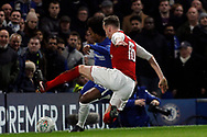 Willian of Chelsea (L) is tackled by Rob Holding of Arsenal (R). Carabao Cup , semi final 1st leg match, Chelsea v Arsenal at Stamford Bridge in London on Wednesday 10th January 2018.<br /> pic by Steffan Bowen, Andrew Orchard sports photography.