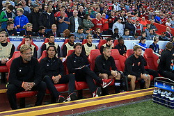 23rd August 2017 - UEFA Champions League - Play-Off (2nd Leg) - Liverpool v 1899 Hoffenheim - Liverpool manager Jurgen Klopp (C) sits in the dugout alongside his assistants - Photo: Simon Stacpoole / Offside.