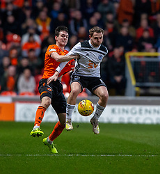 Dundee United's Liam Smith and Ayr United's Alan Forest. half time : Dundee United 1 v 0 Ayr United, Scottish Championship game played 21/12/2019 at Dundee United's stadium Tannadice Park.