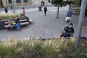 Local women relax on public benches, on 8th October 2019, in Rainham, Essex, England.