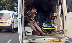 An injured policeman sits in an ambulance during a protest at the India Gate in New Delhi, India, December 23, 2012. Photo by Imago / i-Images...UK ONLY