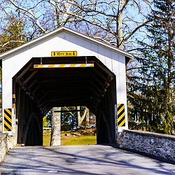 Rothsville, PA / USA - February 3, 2020: Erb's Covered Bridge is an 80 feet span over the Hammer Creek in Lancaster County. Painted red, the approaches are painted in the traditional white.