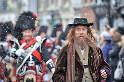 "© Licensed to London News Pictures. 03/12/2017. Rochester, UK.  A participant dressed as Fagin from ""Oliver Twist"" leads the annual Dickensian Christmas Festival in Rochester.  The Kent town is given a Victorian makeover to celebrate the life of the writer Charles Dickens (who spent much of his life there), with Victorian themed street entertainment, costumed parades and a Christmas market.  Photo credit: Stephen Chung/LNP"