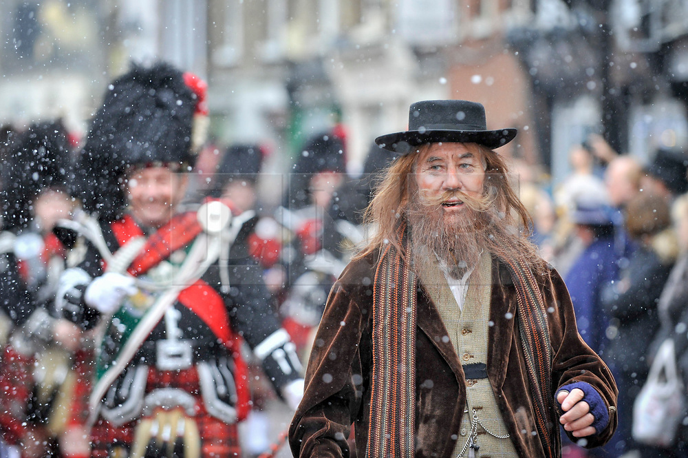 """© Licensed to London News Pictures. 03/12/2017. Rochester, UK.  A participant dressed as Fagin from """"Oliver Twist"""" leads the annual Dickensian Christmas Festival in Rochester.  The Kent town is given a Victorian makeover to celebrate the life of the writer Charles Dickens (who spent much of his life there), with Victorian themed street entertainment, costumed parades and a Christmas market.  Photo credit: Stephen Chung/LNP"""