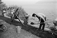 1959. Alain Delon et Romy Schneider Gardening in Lugano, Switzerland.<br /> <br /> 1959. Alain Delon et Romy Schneider faisant du Jardinage à Lugano, Suisse .