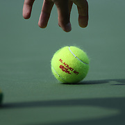 A ball boy picks up a ball during the Maria Sharapova, Russia, in action against Caroline Wozniacki, Denmark, during the US Open Tennis Tournament, Flushing, New York, USA. 31st August 2014. Photo Tim Clayton