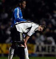 Photo: Jed Wee.<br /> Newcastle United v Chelsea. Carling Cup. 20/12/2006.<br /> <br /> Chelsea matchwinner Didier Drogba consoles Newcastle youngster Paul Huntington.
