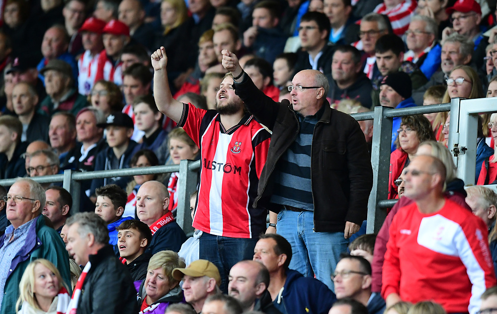 Lincoln City fans watch their team in action<br /> <br /> Photographer Chris Vaughan/CameraSport<br /> <br /> The EFL Sky Bet League Two - Lincoln City v Crawley Town - Saturday September 8th 2018 - Sincil Bank - Lincoln<br /> <br /> World Copyright © 2018 CameraSport. All rights reserved. 43 Linden Ave. Countesthorpe. Leicester. England. LE8 5PG - Tel: +44 (0) 116 277 4147 - admin@camerasport.com - www.camerasport.com