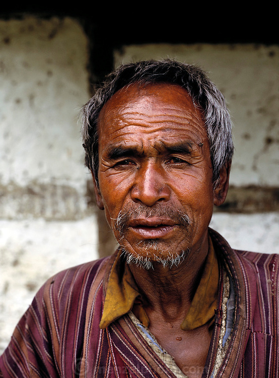 Man who has been drinking to excess, Shingkhey Village, Bhutan. From Peter Menzel's Material World Project.