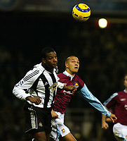 Photo: Chris Ratcliffe.<br />West Ham United v Newcastle United. The Barclays Premiership. 17/12/2005.<br />Bobby Zamora (R) of West Ham and Titus Bramble battle it out.