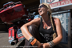 """""""Throttle Girl"""" Kelly Quin at the Iron Horse Saloon after the Harley-Davidson Angels Ride to benefit the Nature Conservancy during the annual Sturgis Black Hills Motorcycle Rally.  SD, USA.  August 12, 2016.  Photography ©2016 Michael Lichter."""