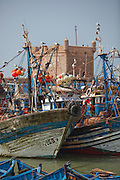 Fishing boats moored at the dock in the town of Essaouira in Morocco