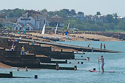 © Licensed to London News Pictures 22/07/2021. Whitstable, UK. Whitstable Bay. Another hot heatwave day as people enjoy a day out at Whitstable in Kent. Photo credit:Grant Falvey/LNP