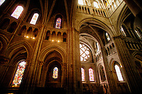 The South Rose Window, arch windows, and stained glass  in the Cathedral of Notre Dame of Lausanne, Switzerland