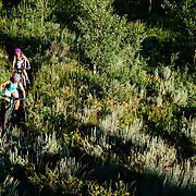 Heather and Jade Goodrich mountain bike single track near Jackson, Wyoming.