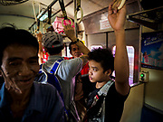 11 APRIL 2018 - BANGKOK, THAILAND:  People stand on a train to Ayutthaya on the first day of the Songkran travel period. Songkran is the traditional Thai New Year and is one of the busiest travel periods of the year as Thais leave the capital and go back to their home provinces or resorts in tourist areas. Trains and busses are typically jammed the day before the three day Songkran holiday starts. The government has extended the official holiday period through Monday, 16 April because one day of the Songkran holiday fell on the weekend, giving many workers a five day holiday.    PHOTO BY JACK KURTZ