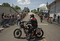 Lewis Leonard gets into starting position on his 1937 Indian Scout during the Tower Hill Climb on Tuesday in Weirs Beach.  (Karen Bobotas/for the Laconia Daily Sun)