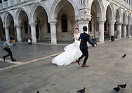 The San Marco Piazza in Venice becomes a popular spot for wedding photography in the early morning hours before the crowds arrive.