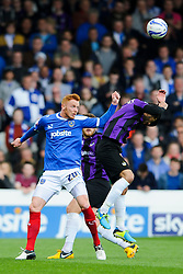 Danny Woodards (ENG) of Bristol Rovers is pushed by Ryan Taylor (ENG) of Portsmouth - Photo mandatory by-line: Rogan Thomson/JMP - 07966 386802 - 19/04/2014 - SPORT - FOOTBALL - Fratton Park, Portsmouth - Portsmouth FC v Bristol Rovers - Sky Bet Football League 2.