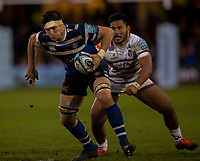 Bath Rugby's Francois Louw evades the tackle of Leicester Tigers Manu Tuilagi<br /> <br /> Photographer Bob Bradford/CameraSport<br /> <br /> Gallagher Premiership Round 11 - Bath Rugby v Leicester Tigers - Sunday 30th December 2018 - The Recreation Ground - Bath<br /> <br /> World Copyright © 2018 CameraSport. All rights reserved. 43 Linden Ave. Countesthorpe. Leicester. England. LE8 5PG - Tel: +44 (0) 116 277 4147 - admin@camerasport.com - www.camerasport.com