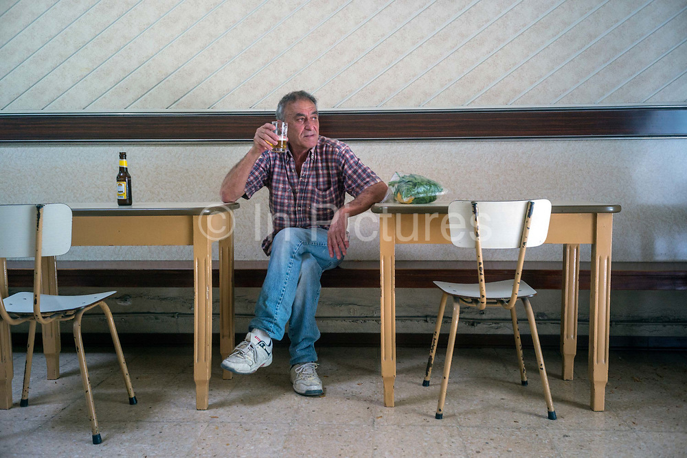 A man drinks a beer in the Coney Island Bar in Victoria, the capital of the island of Gozo in Malta. The bar, opened in the 1960s is a tiny but classic Modernist cafe.