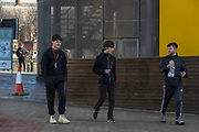 People walk by the city centre's Times Square nearby Life Science laboratory in Newcastle on Tuesday, March 16, 2021. With its twin city, Gateshead, Newcastle is known to be a university city on the River Tyne in northwest England. (Photo/ Vudi Xhymshiti)