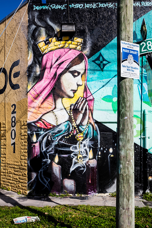 A praying Madonna painted on a wall in Miami's Wynwood Arts District, home to hundreds of diverse murals.