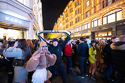 A large crowd of young people has built up outside Harrods as London remains in Tier 2 during the coronavirus pandemic and it was clear that masks weren't being worn and they were not paying any attention to social distancing, the Metropolitan Police were present in Knightsbridge, London, Great Britain<br /> 5th December 2020<br /> <br /> Pictures taken around 1730hrs on 5th December - hundreds of young people were in the streets around Harrods - it later transpired that they were teenagers from traveller communities who visit Knightsbridge on the first Saturday of December each year. The images on this gallery went viral around the world, many people were very shocked to see so many people crammed into a small space  not wearing masks or socially distanced during the global Coronavirus pandemic. <br /> <br /> Photograph by Elliott Franks