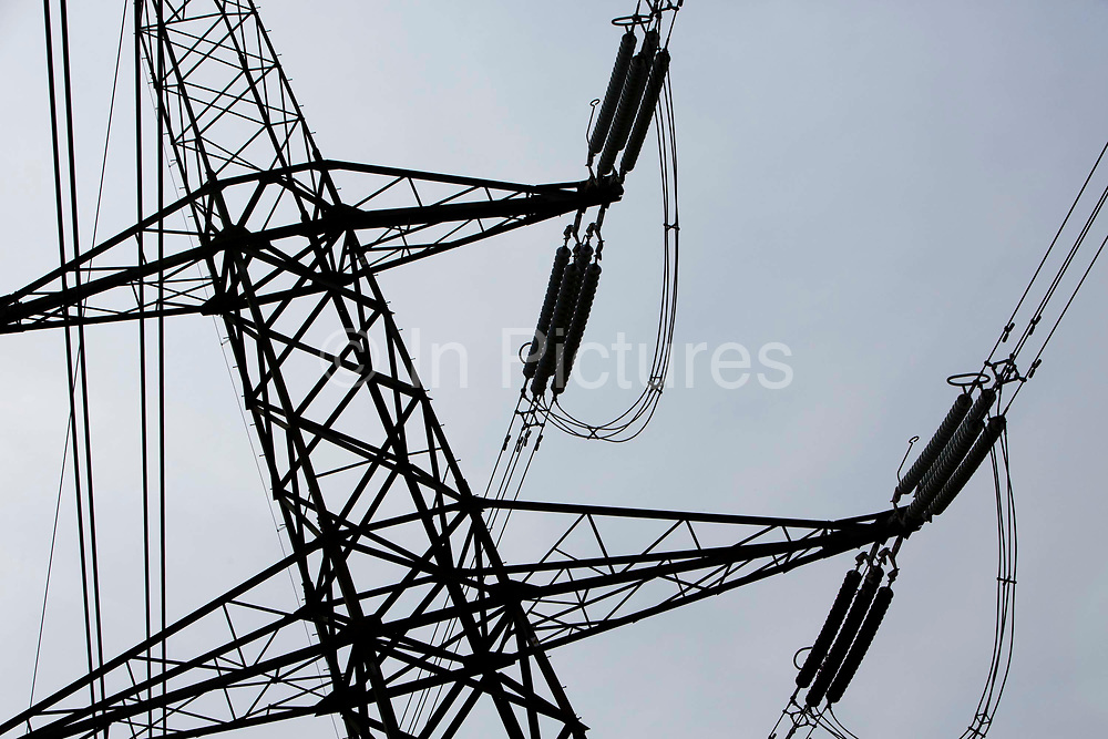 400 kV overhead electricity power lines suspended by pylons and used to transmit electric energy across large distances across Oxfordshire, United Kingdom.