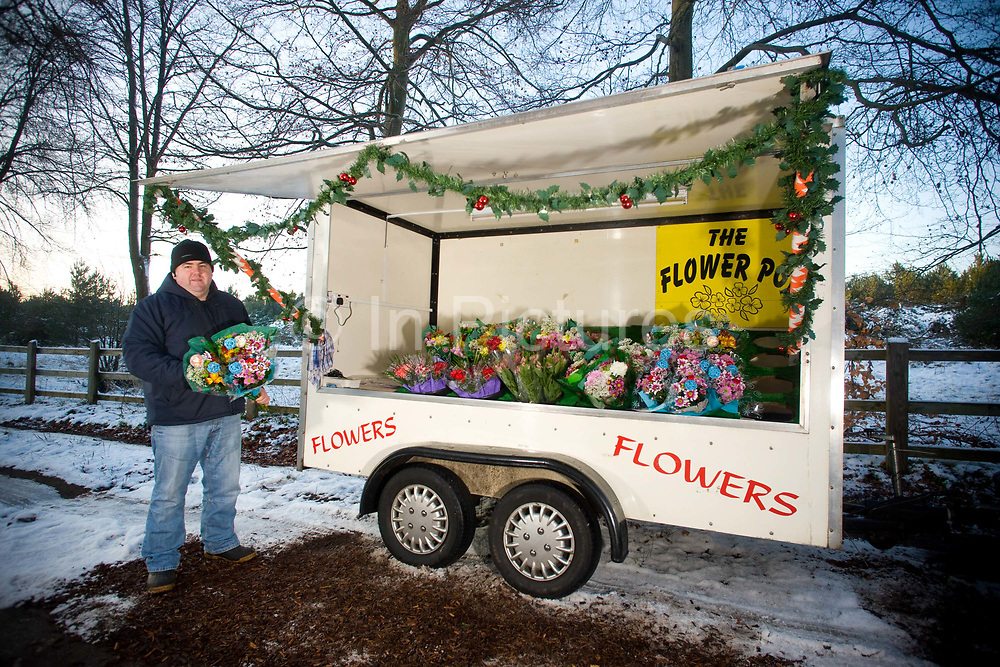 David Wortley selling flowers at his roadside business called The Flower Pot in a layby on the busy A11 on the 22nd December 2009 in Thetford in the United Kingdom.