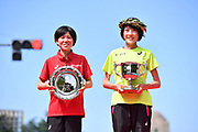 Honami Maeda (right) and Ayuko Suzuki pose after placing first and second in the women's race during the Marathon Grand Championship, Sunday Sept. 15 2019, in Tokyo to qualify for the Japanese team for the 2020 Olympics. (Agence SHOT/Image of Sport)