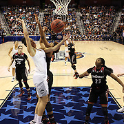 Gabby Williams, UConn, is fouled by Marley Hill, Cincinniti, during the UConn Vs Cincinnati Quarterfinal Basketball game at the American Women's College Basketball Championships 2015 at Mohegan Sun Arena, Uncasville, Connecticut, USA. 7th March 2015. Photo Tim Clayton