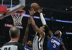 November 15, 2018 - Los Angeles, California, U.S - Montrezl Harrell #5 of the Los Angeles Clippers blocks DeMar DeRozan #10 of the San Antonio Spurs during their NBA game on Thursday November 15, 2018 at the Staples Center in Los Angeles, California. Clippers defeat Spurs, 116-111. (Credit Image: © Prensa Internacional via ZUMA Wire)