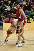 Matt Trueman takes on Alex Pledger during their round 16 game in Hamilton,NBL 2011,Waikato Pistons Vs Otago Nuggets,Hamilton Boys' High,Hamilton.  Saturday 9 July 2011.<br /> Photo: Dion Mellow / photosport.co.nz